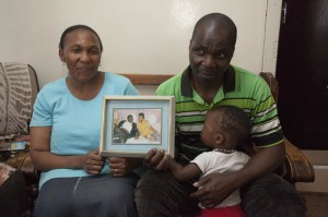 Happy Phiri and his wife Pearlma Buthelezi hold a photo of their first date. Phiri wasn't sure his wife would wait for him while he served his prison sentence. Photo: Jay Caboz