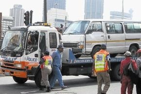 A file photo showing JMPD officers impounding a taxi (Photo: Mabuti Kali for the Sowetan)