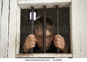 stock-photo-rowdy-behind-ancient-prison-bars-focus-is-on-the-hands-adobe-rgb-915680